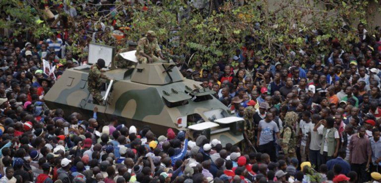 An APC navigates a crowd during anti-Mugabe demonstrations in Zimbabwe. CC Flickr Zimbabwean-eyes, modified, https://creativecommons.org/publicdomain/mark/1.0/