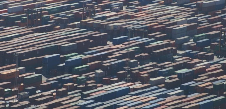 Shipping containers in Barcelona, cc Flickr David Merrett, modified, https://creativecommons.org/licenses/by/2.0/