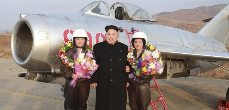 North Korean leader Kim Jong Un poses for pictures with female pilots as he provides field guidance to the flight drill of female pilots of pursuit planes of the KPA Air and Anti-Air Force in this undated photo released by North Korea's Korean Central News Agency (KCNA) in Pyongyang November 28, 2014. cc Flickr Robert Sullivan, modified, public domain, https://creativecommons.org/publicdomain/mark/1.0/