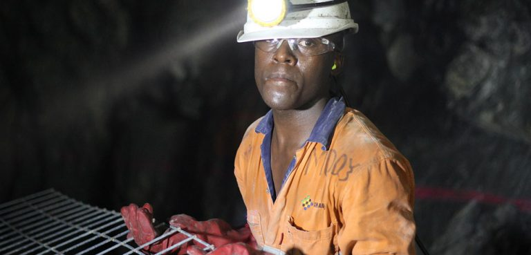 Miner, cc Deo Photographer, modifeid, https://commons.wikimedia.org/w/index.php?title=Special:Search&limit=500&offset=0&ns0=1&ns6=1&ns14=1&search=africa+mine&advancedSearch-current=%7B%7D&searchToken=74ari222q016v8zsx26p48rmg#%2Fmedia%2FFile%3AMine_boy.jpg