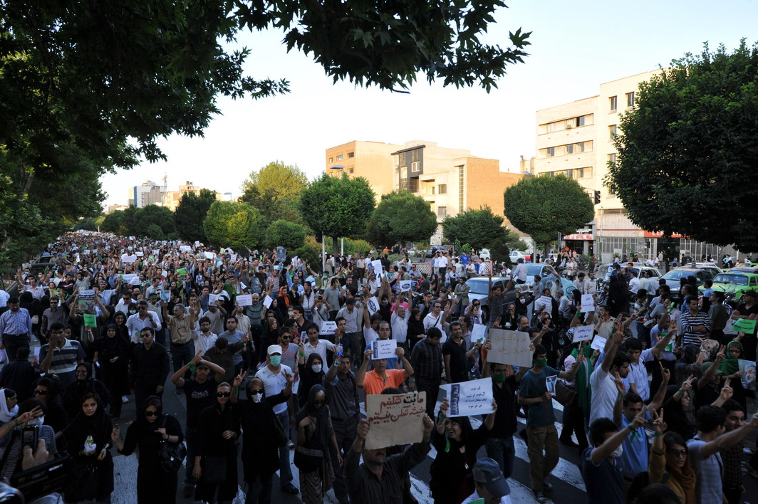 A picture from the Tehran protests of 2009, cc Milad Avazbeigi, modified, https://commons.wikimedia.org/wiki/File:Tehran_protests_(2).jpg