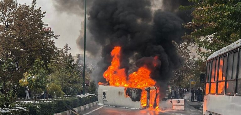Iran Fuel Protests, cc Fars News Agency, wikicommons, modified, https://commons.wikimedia.org/w/index.php?title=Special:Search&limit=500&offset=0&ns0=1&ns6=1&ns14=1&search=iran+protest&advancedSearch-current=%7B%7D&searchToken=7b2lb0b650k35fu08drjgghrf#%2Fmedia%2FFile%3A2019_Iranian_fuel_protests_Fars_News_%282%29.jpg
