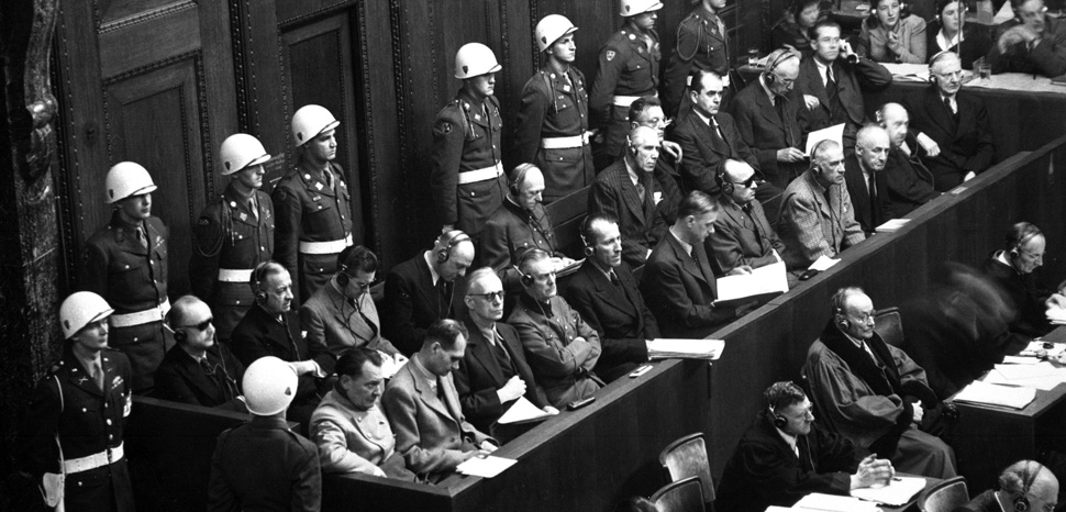 Nuremberg Trials, modifeid, Public Domain. Additional source and credit info from source: Nuremberg Trials. Looking down on defendants' dock, ca. 1945-46. (WWII War Crimes Records) Exact Date Shot Unknown NARA FILE #: 238-NT-592 WAR & CONFLICT BOOK #: 1296