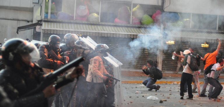 Tear gas, and plastic pellet gunshot used by Venezuela's National Police against a protest in Altamira, Caracas., cc Andrés E. Azpúrua, modiofied, https://commons.wikimedia.org/wiki/File:Tear_gas_used_against_protest_in_Altamira,_Caracas;_and_distressed_students_in_front_of_police_line.jpg