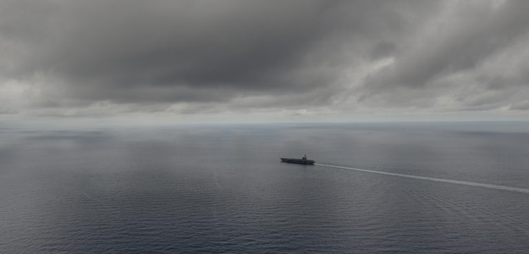The USS Ronald Reagan transits the South China Sea, cc Flickr Official U.S. Navy Page, modified, https://creativecommons.org/licenses/by/2.0/ / SOUTH CHINA SEA (July 5, 2016) The Navy's only forward-deployed aircraft carrier USS Ronald Reagan (CVN 76) transits the South China Sea. Ronald Reagan, the Carrier Strike Group Five (CSG 5) flagship, is on patrol in the U.S. 7th Fleet area of responsibility supporting security and stability in the Indo-Asia-Pacific region. (U.S. Navy photo by Mass Communication Specialist 3rd Class Nathan Burke/Released) 160705-N-OI810-110