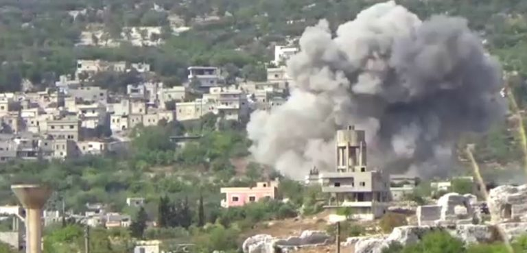 A strike in Bidama in Idlib in 2017; cc Qasioun News Agency, modified, https://en.wikipedia.org/wiki/Hama_offensive_(September_2017)#/media/File:Airstrike_in_Bidama,_west_of_Idlib.jpg