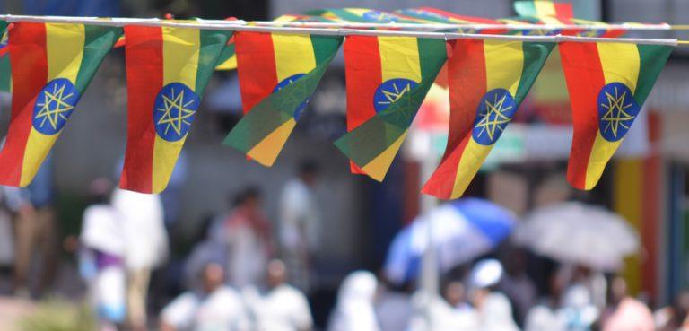EthiopiaFlag, cc Flickr John Iglar, modified, https://creativecommons.org/licenses/by-sa/2.0/