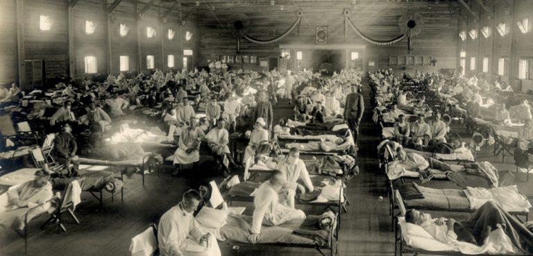 Otis Historical Archives, modified, https://commons.wikimedia.org/wiki/File:Emergency_hospital_during_Influenza_epidemic,_Camp_Funston,_Kansas_-_NCP_1603.jpg, CC 2.0, modified