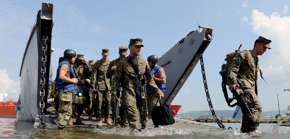 130627-N-YU572-174 SUBIC BAY, Philippines (June 27, 2013) - Sailors and Marines disembark landing craft utility (LCU) 1633 to support Cooperation Afloat Readiness and Training (CARAT) Philippines 2013. More than 600 Sailors and Marines are participating in CARAT Philippines 2013. U.S. Navy ships participating in CARAT Philippines include the guided missile destroyer USS Fitzgerald (DDG 62), with embarked Destroyer Squadron (DESRON) 7 staff, the amphibious dock landing ship USS Tortuga (LSD 46) with embarked U.S. Marine Corps landing force, and the diving and salvage vessels USNS Safeguard (T-ARS 50) and USNS Salvor (T-ARS 52) with embarked Mobile Diving and Salvage Unit (MDSU) 1. CARAT is a series of bilateral military exercises between the U.S. Navy and the armed forces of Bangladesh, Brunei, Cambodia, Indonesia, Malaysia, the Philippines, Singapore, Thailand and Timor Leste. (U.S. Navy photo by Mass Communication Specialist 1st Class Jay C. Pugh) (RELEASED), cc Flickr Cooperation Afloat Readiness and Training (CARAT) Commander, Logistics Group Western Pacific, modified, https://creativecommons.org/licenses/by/2.0/