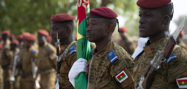 BurkinaFasoFlintlock2019, Members of the Burkinabe honor guard stand ready to be called to attention before the opening ceremony of Flintlock 2019, in Ouagadougou, Burkina Faso. Flintlock is an annual African-led, integrated military and law enforcement exercise that has strengthened key partner nation forces throughout North and West Africa as well as western special operations forces since 2005. (U.S. Navy photo by MC2 (SW/AW) Evan Parker / released), https://www.africom.mil/media-room/article/31543/more-than-30-nations-kick-off-flintlock-2019-in-burkina-faso-mauritania