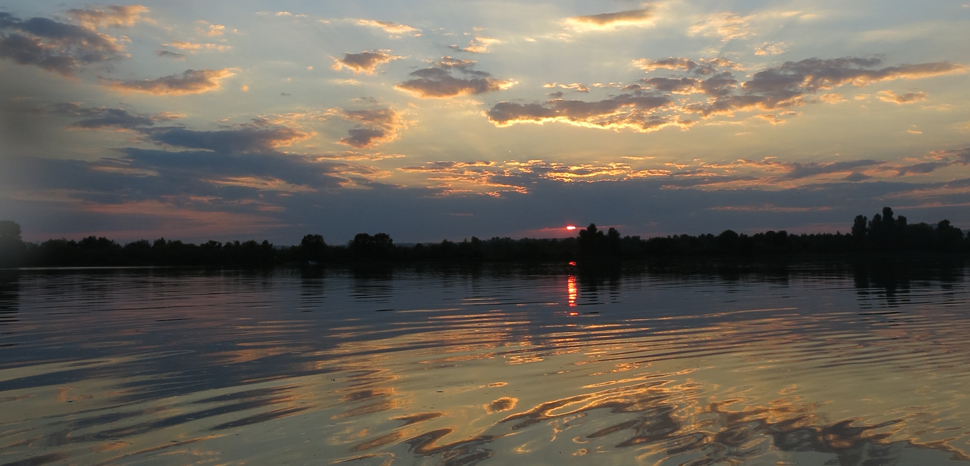 Sunset over the Dnieper River, which once met most of Crimea's water needs,, cc Flickr tuyddatygl, modified, https://creativecommons.org/licenses/by-sa/2.0/