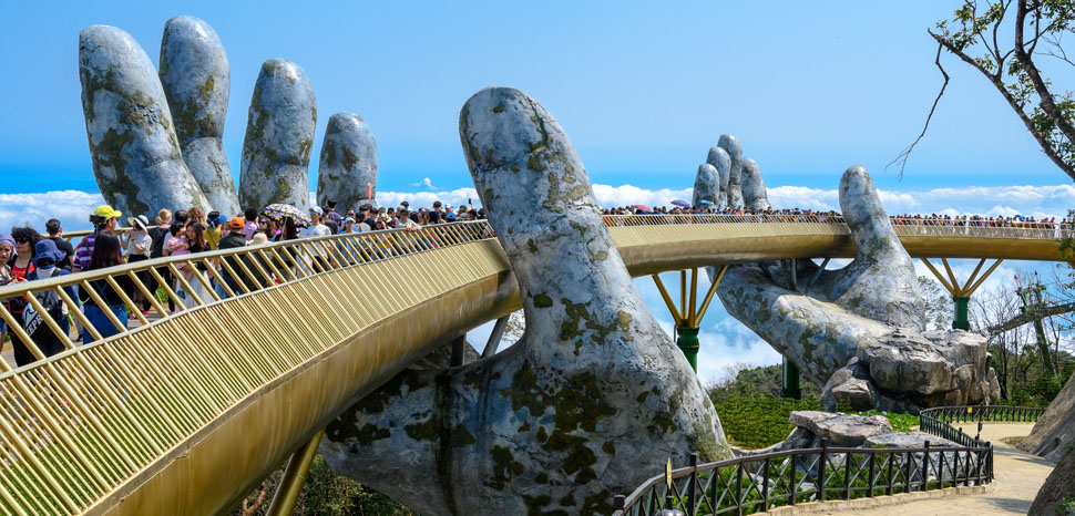 cc xiquinhosilva, modified, https://commons.wikimedia.org/wiki/File:Golden_Bridge_Da-Nang.jpg