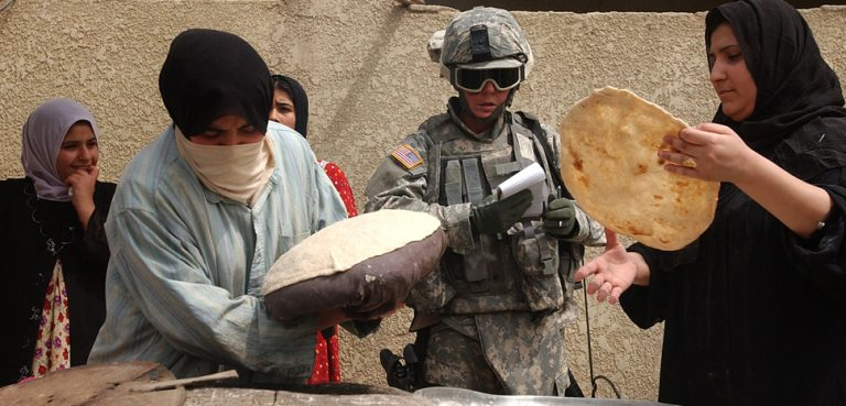 cc The U.S. Army , Flickr, modified, https://creativecommons.org/licenses/by/2.0/, U.S. Army Spc. Christine Foster, with 478th Civil Affairs Company, is taught how to make flat bread by local Iraqi women during a routine meet and greet in the Al Rasheed area of Mahmudiyah, Iraq, May 5, 2007. (U.S. Army photo by Sgt. Jacob H. Smith) (Released)