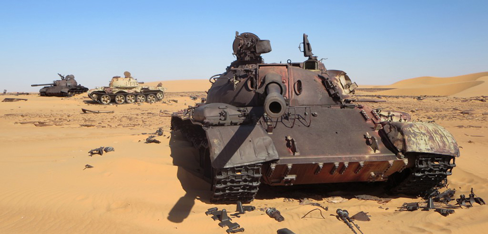 Three old Libyan tanks, derelict after the failed intervention in the Chadian civil war. cc Flickr David Stanley, modified, https://creativecommons.org/licenses/by/2.0/