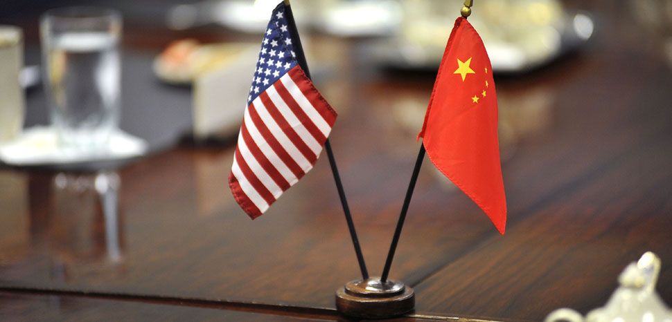cc U.S. Deputy Secretary of Defense David L. Norquist Flickr, modified, The American and Chinese flags stand at center table shortly before Deputy Secretary of Defense Ashton B. Carter welcomes Deputy Chief of the General Staff of the People's Liberation Army Cai Yingting of China to a meeting at the Pentagon, August 23, 2012. (DoD Photo By Glenn Fawcett)