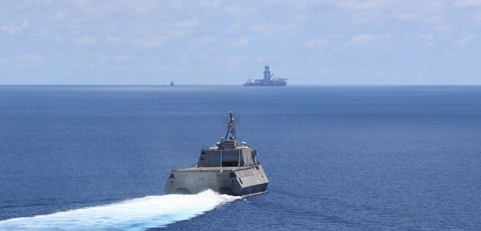 public domain, modified, https://www.amphib7flt.navy.mil/Media/News/Article/2180588/montgomery-cesar-chavez-operate-near-west-capella/, SOUTH CHINA SEA (May 7, 2020) The Independence-variant littoral combat ship USS Montgomery (LCS 8) conducts routine operations near Panamanian flagged drillship, West Capella, May 7. Montgomery is on a rotational deployment to USINDOPACOM, conducting operations, exercises and port visits throughout the region and working hull-to-hull with allied and partner navies to provide maritime security and stability, key pillars of a free and open Indo-Pacific. (U.S. Navy photo by Naval Aircrewmen Helicopter 3rd Class Christopher Fred) (Photo by AWS3 Christopher Fred)