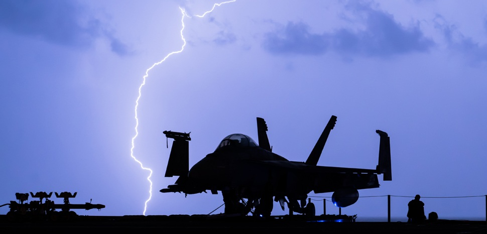 ARABIAN GULF (Dec. 16, 2017) Lightning strikes near the aircraft carrier USS Theodore Roosevelt (CVN 71) as it transits the Arabian Gulf. Theodore Roosevelt and its carrier strike group are deployed to the U.S. 5th Fleet area of operations in support of maritime security operations to reassure allies and partners and preserve the freedom of navigation and the free flow of commerce in the region. (U.S. Marine Corps photo by 1st Lt. Mark Vetere/Released)171216-M-DI829-1001 , cc Flickr Official U.S. Navy Page, modified, https://creativecommons.org/licenses/by/2.0/