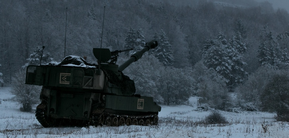 cc US Army Flickr, modified, A U.S. Army Paladin assigned to Battery C, 1st Battalion, 7th Field Artillery Regiment, 2nd Armored Brigade Combat Team, 1st Infantry Division, Fort Riley, Kansas, stands ready to fire during training at Hohenfels, Germany Jan. 22, 2018. The 2nd ABCT is among the units from 10 nations participating in Allied Spirit VIII, a multinational exercise designed to test participants' readiness and build upon existing relationships. U.S. Army photo by Spc. Dustin D. Biven., public domain