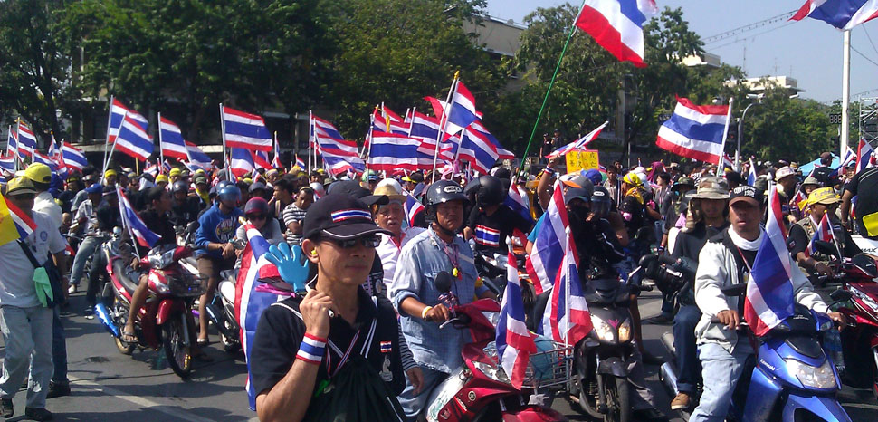 Thai protests in 2013, cc ilf_, modified, https://commons.wikimedia.org/wiki/File:Protesters_on_motorcycles_in_Bangkok,_1_December_2013.jpg