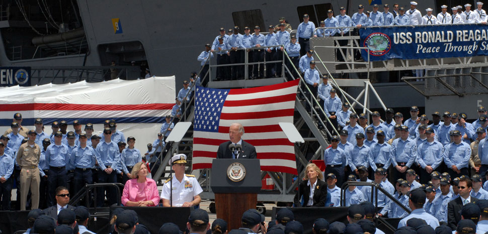 NAVAL AIR STATION, North Island (May 14, 2009) Vice President Joe Biden addresses the crew of the Nimitz-class aircraft carrier USS Ronald Reagan (CVN 76). The Vice President and his wife, Dr. Jill Biden, visited Ronald Reagan during a familiarization tour of naval facilities in the San Diego area. Ronald Reagan is preparing for its upcoming deployment to the Western Pacific and Indian Ocean later this spring. (U.S. Navy photo by Mass Communication Specialist 3rd Class Briana C. Brotzman/Released), modified, US Navy, https://commons.wikimedia.org/wiki/File:US_Navy_090514-N-2344B-204_Vice_President_Joe_Biden_addresses_the_crew_of_the_Nimitz-class_aircraft_carrier_USS_Ronald_Reagan_(CVN_76).jpg