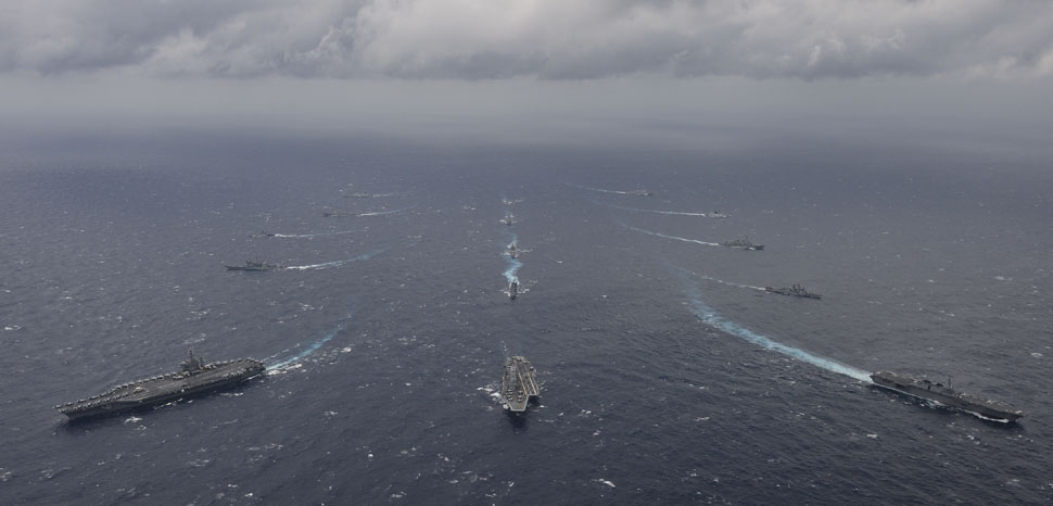 BAY OF BENGAL (July 17, 2017) Ships from the Indian Navy, Japan Maritime Self-Defense Force (JMSDF) and the U.S. Navy sail in formation, July 17, 2017, in the Bay of Bengal as part of Exercise Malabar 2017. Malabar 2017 is the latest in a continuing series of exercises between the Indian Navy, JMSDF and U.S. Navy that has grown in scope and complexity over the years to address the variety of shared threats to maritime security in the Indo-Asia-Pacific region. (U.S. Navy photo by Mass Communication Specialist 3rd Class Cole Schroeder), cc Flickr ermaleksandr, modified, https://creativecommons.org/publicdomain/mark/1.0/