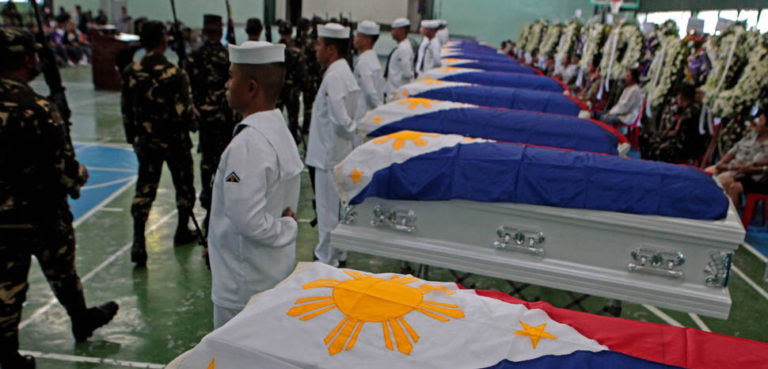 Military honors bestowed on 15 AFP soldiers killed in combat against Abu Sayyaf in 2016, public domain, ROBINSON NIÑAL/PPD, modified, https://commons.wikimedia.org/wiki/File:The_15_gallant_soldiers_killed_in_combat_with_the_Abu_Sayyaf_in_Sulu_are_given_full_military_honors.jpg