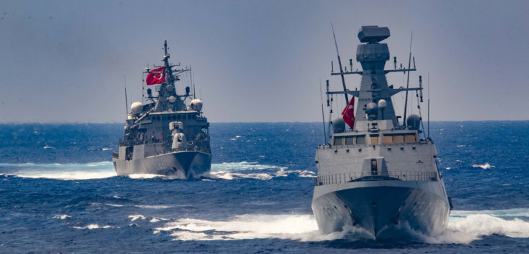 MEDITERRANEAN SEA (Aug. 26, 2020) The Arleigh Burke-class guided-missile destroyer USS Winston S. Churchill (DDG 81), not pictured, executes a passing exercise with Turkish Navy frigates TCG Barbaros (F-244) and Burgazada (F-513) in the Mediterranean Sea, Aug. 26, 2020. Winston S. Churchill is deployed to the U.S. 6th Fleet area of operations in support of regional allies and partners and U.S. national security interests in Europe and Africa., modified, cc Flickr Commander, U.S. Naval Forces Europe-Africa/U.S. 6th Fleet, https://www.flickr.com/photos/cne-cna-c6f/50271831981/in/photolist-2jAmhcP-2haMApM-2haNErD-2gaP4QR-2hD6juY-RH5CUJ-2bF67ti-VxBNes-2hGRkqA-HCFGuD-2hqdMu5-2gEg8cf-2gUiawX-2hDgcCX-SZ1JT1-2gaN4qq-2hqfRnp-2gVhEXN-2hGDfKh-2haMAkF-2hFdvj2-2hGn39m-znkBA5-2gUirnE-2hDctte-2haQaMz-2hFnDn3-H43vF2-2gaNDEb-2gaN4jh-2gWgQxW-2hrHEYA-2hqchm2-2g5ya9R-2hHNyyf-2hFoA2d-2haRtoR-2haRirw-2hmSiv2-2gaNhSi-BdTSWE-2hGy2zf-2gaNooQ-2h5oRbS-2hFnuSh-2ghxo1s-2g5DKwy-2hrMBEh-24qHQwD-2cRhAAQ
