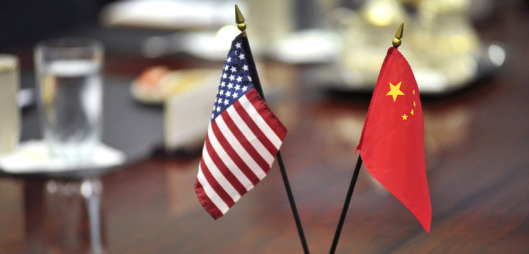 The American and Chinese flags stand at center table before U.S. Deputy Defense Secretary Ashton B. Carter welcomes Cai Yingting, Chinese deputy chief of the General Staff of the People's Liberation Army, to a meeting at the Pentagon, Aug. 23, 2012., cc modified, https://commons.wikimedia.org/wiki/File:Defense.gov_photo_essay_120823-D-NI589-007.jpg