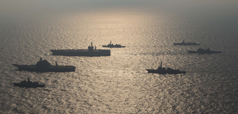Ships from the Royal Australian Navy, Indian navy, Japan Maritime Self-Defense Force and the United States Navy participate in Malabar 2020., cc Flickr Official U.S. Navy Page, modified, https://www.flickr.com/photos/usnavy/50613870887/in/photolist-2k7zjsk-2k8s7Fo-2k89r7Y-CwWaMh-VAfibR-WRGbUK-Vy11vY-VABjDi-Vy12ij-Vy11WY-VxZZwo-WLxHNh-Vy115Y-YyiLr5-2dTgKFL-ZKcBLA-ZMX6cZ-ZJdAZ9-FRntMV-W35JeS-WH1K2J-WEc1eM-WEbZ9k-XiQ3Wi-L1sqBu-L1sqks-L1sqSE-2dTg7Xf-2dAocUi-2dThcf1-2eZe3Pn-5DFc39-2853ShY-Vsm6Ad-VsYesT-VzHAWo-WASr2E-Wt8vjV-VsYdyD-WgyQ6J-WASqmG-W5saTj-WgyNP5-WgyP4y-WNhu1L-WJyqWR-WgyQHA-WgyPsu-W7bPss-2853RBu