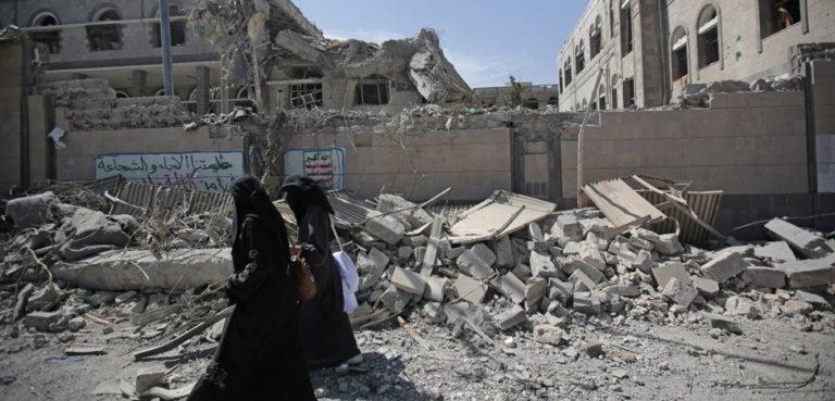 cc Flickr Felton Davis, modified, May 7th - Yemenis walk past rubble after deadly airstrikes in and near the presidential compound, in Sanaa, https://www.flickr.com/photos/felton-nyc/41162497535/in/photolist-x1uAoQ-25Hoyrn-2fBqYWT-278Vcw2-22btvxc-X7Pcmk-TNSbk3-2fWtXKV-yDThYU-2fBqYZD-zAZwCM-zyDgBs-zjj6a1-2eft1zq-2fSxqZd-2fBqYZ8-RR1Ffz-2fBqYY6-278VcuZ-278Vcz8-2jVuzmV-25dmwjx-2jFsuJL-2hna13k