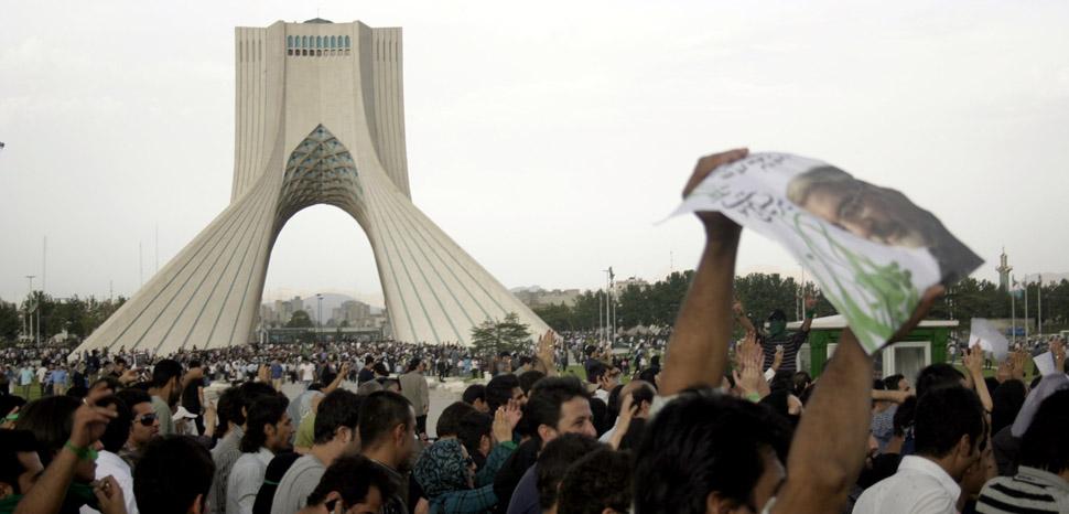 Protests following elections in 2009, cc Flickr Iran Election 2009, modified, https://flickr.com/photos/iran09/3630172397/in/photolist-6xocPd-6wWJ4X-qK2o3x-r2i7X8-6wMAsr-6xxiG6-6xocPq-6xxo6B-6XrKqu-6Gq8Sy-6x7s2o-6xxiGn-6xxiGD-6wRNu6-6wRM4m-6xxiGc-6x7qWu-6x3gw2-6xocNW-6x3gLn-6wRNu8-6yLVPR-6Gq8Sh-6Gq8Sq-6xocP1-6Gq8Sb-6AdfEg-6Gq8S7-6xocPj-6Gq8S5-6xxiG4-6AdfEF-6AdfED-6xxiFF-q5rDAu-6AdfEv-6AdfEr-6xpmte-6AdfEH-6yvNQi-6wMA9c-6wRKX7-6wMzMg-6XrL8Y-6wRLiA-6wMztc-BLMHx-7Gog8d-BLMHM-BLMHH