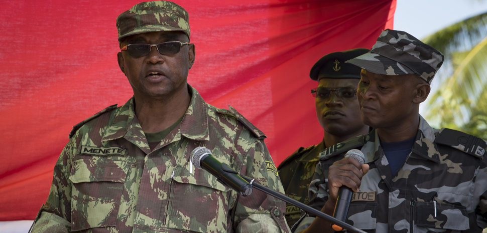 PEMBA, Mozambique (Jan. 29, 2019) General of the Army Lazaro Menete, chief of staff of the Mozambican Armed Forces, speaks during the opening ceremony of exercise Cutlass Express 2019 in Pemba, Mozambique, Jan. 29, 2019. Cutlass Express is designed to improve regional cooperation, maritime domain awareness and information sharing practices to increase capabilities between the U.S., East African and Western Indian Ocean nations to counter illicit maritime activity. (U.S. Navy photo by Mass Communication Specialist 1st Class Kyle Steckler/Released), cc Flickr modified, Commander, U.S. Naval Forces Europe-Africa/U.S. 6th Fleet, https://flickr.com/photos/cne-cna-c6f/46004465185/in/photolist-2kNQP1b-2h7cNbz-8uNQKo-7WrvjL-9ptDm4-9s7aPC-8uNPNs-8uKMLK-8EqYsv-8EqYkH-8Eu8zd-7Wofq6-8uNPLJ-8vgTKg-8uKLGt-6tCvpF-8uNR1o-8uKMkt-8uKN4r-8uKLDc-8ygV66-8yjYqJ-8uKKTx-8uKNiK-nSVh8c-8uKLt6-8uNQYG-8uNQH9-8uKNav-8uNPk3-8uKLBc-9phppg-8uNPX9-9s4bCX-9s4bR8-9s4bzR-8ygUZV-cXEWDW-cXEWpm-RhoVPm-cXEWdo-cXEVVL-2d6fUpB-2d6fUJe-cXEW6b-cXEW2o-cXEWjm-cXEVSu-9qhgiS