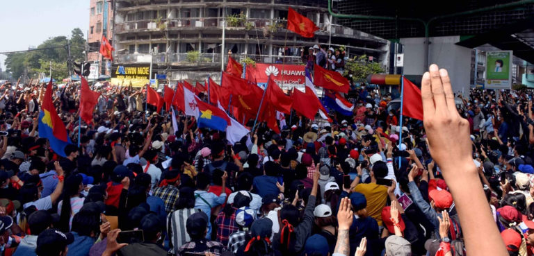 cc VOA Burmese, modified, https://commons.wikimedia.org/w/index.php?title=Special:Search&redirs=0&search=yangon%20protest&fulltext=Search&ns0=1&ns6=1&ns14=1&title=Special:Search&advanced=1&fulltext=Advanced%20search#/media/File:Protesters_participate_in_an_anti-military_rally.jpg