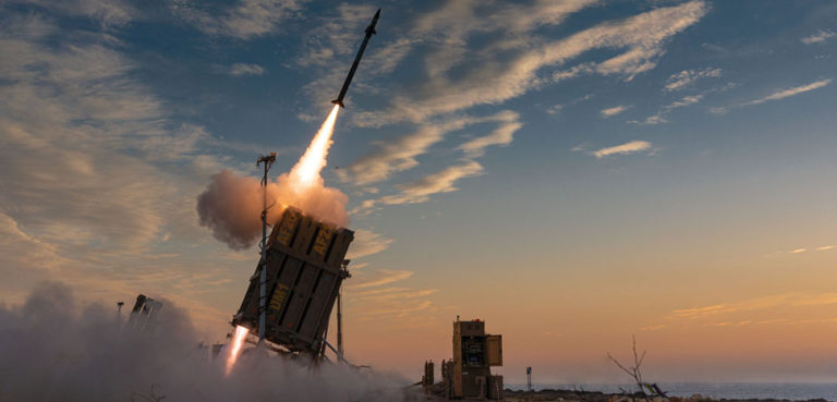 cc Avichai Socher, modified, https://commons.wikimedia.org/w/index.php?sort=last_edit_desc&search=iron+dome+filetype%3Abitmap&title=Special%3ASearch&profile=advanced&fulltext=1&advancedSearch-current=%7B%22fields%22%3A%7B%22filetype%22%3A%22bitmap%22%7D%7D&ns0=1&ns6=1&ns14=1#/media/File:Operation_Guardian_of_the_Walls,_May_2021._XXXVII.jpg