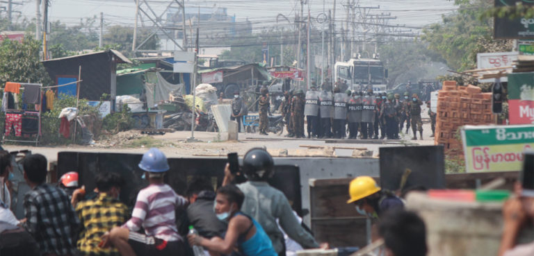 VOA news, modified, https://commons.wikimedia.org/wiki/File:Protesters_and_police_face_off_in_Mandalay.webp