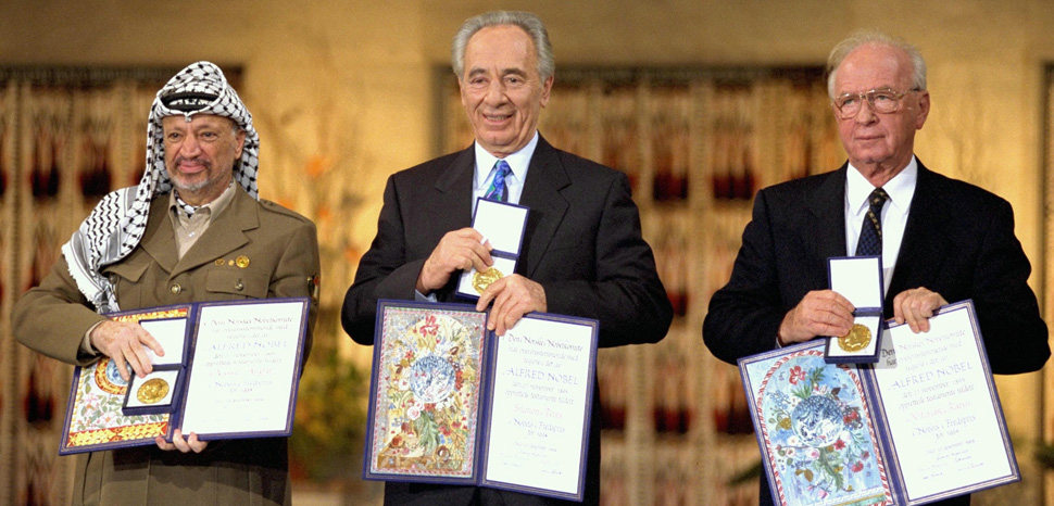 he Nobel Peace Prize laureates for 1994 in Oslo. From left to right: PLO Chairman Yasser Arafat, Israeli Foreign Minister Shimon Peres, Israeli Prime Minister Yitzhak Rabin, cc Government Press Office, modified, https://commons.wikimedia.org/wiki/File:Flickr_-_Government_Press_Office_(GPO)_-_THE_NOBEL_PEACE_PRIZE_LAUREATES_FOR_1994_IN_OSLO..jpg