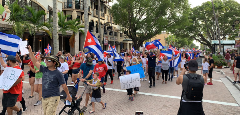 A 2021 solidarity protest in Naples, Florida, cc P,TO 19104, modified, https://commons.wikimedia.org/wiki/File:2021_Cuban_government_protest_in_Naples_Florida.jpg
