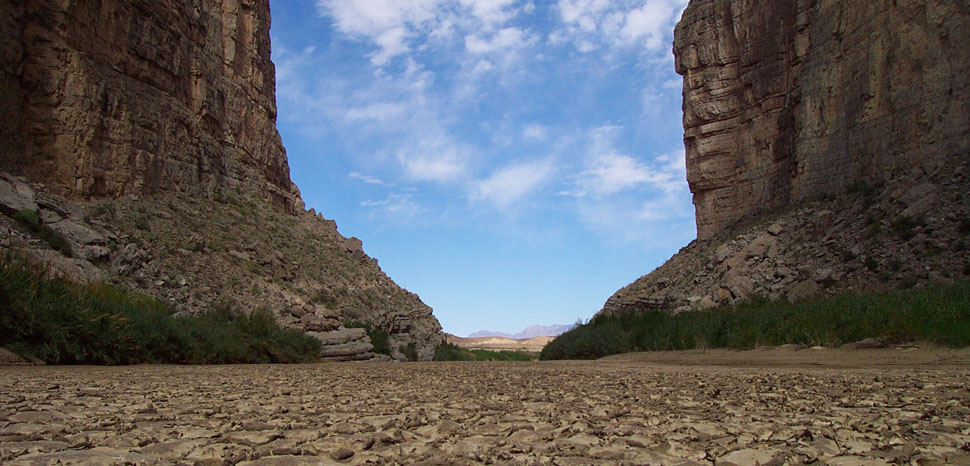 Dry riverbed in Santa Elena Canyon in Big Bend National Park, Texas, United States. Rio Grande facing downstream (Mexico on right, United States on left). Note: The river was flowing adjacent, large enough for people to canoe down it. This photo is a closeup of a sand bar., cc SCEhardt, modified, public domain, https://en.wikipedia.org/wiki/File:Big_Bend_National_Park_-_Rio_Grande_riverbed_with_cracked_mud.jpg