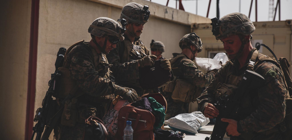 210818-M-TU241-1001 HAMID KARZAI INTERNATIONAL AIRPORT, Afghanistan (August 18, 2021) Marines with the 24th Marine Expeditionary Unit (MEU) search luggage during an evacuation at Hamid Karzai International Airport, Kabul, Afghanistan, Aug. 18. U.S. Marines are assisting the Department of State with an orderly drawdown of designated personnel in Afghanistan., U.S. Marine Corps photo by Sgt. Isaiah Campbell/U.S. Central Command Public Affairs , modified, https://commons.wikimedia.org/w/index.php?title=Special:Search&redirs=0&search=kabul%20airport&fulltext=Search&ns0=1&ns6=1&ns14=1&title=Special:Search&advanced=1&fulltext=Advanced%20search#/media/File:Marines_with_the_24th_Marine_Expeditionary_Unit_(MEU)_search_luggage_during_an_evacuation_at_Hamid_Karzai_International_Airport,_Kabul,_Afghanistan,_Image_6_of_8.jpg