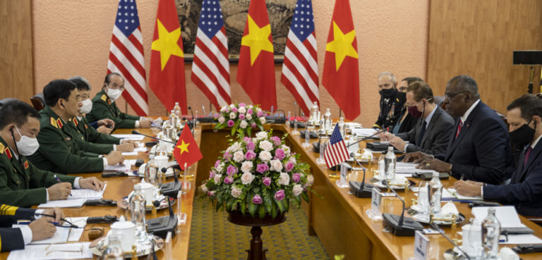 Secretary of Defense Lloyd J. Austin III and Vietnamese Defense Minister Phan Van Giang enter conduct bi-lateral discussions at the Vietnam Ministry of Defense, Hanoi, Vietnam, July 29, 2021. Austin is on a week-long trip to reaffirm defense relationships and conduct bilateral meetings with senior officials in Vietnam, Singapore and Manila, Philippines. (DoD photo by Chad J. McNeeley), cc U.S. Secretary of Defense, modified, https://www.flickr.com/photos/secdef/51343158874/in/photostream/rg/licenses/by/2.0/