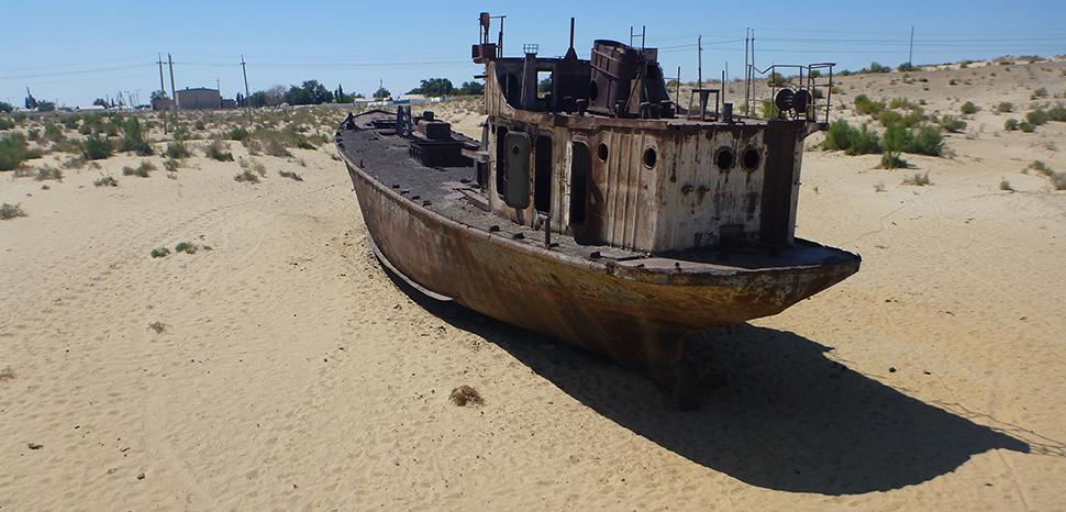 A boat near the shrinking Aral Sea, Uzbekistan; cc Anton Ruiter, Flickr, modified, https://flickr.com/photos/antonruiter/6317973207/in/photolist-aCigjx-2iEcVy4-2jz5sjq-24QEhq4-2faRRcS-aCi1Mg-aChR3R-aCih9H-aChSkp-2gcsBGm-2k9SNen-2m9kJnC-2kCPuvH-2i8ii1e-2hX7VL5-2k42J5Z-2kYMauC-2jopMA9-cCg8bm-2hnpAQZ-2hY95JU-2jyiyUr-25dwdMi-2jDAo6Z-2m4MZKY-SZfvD7-aCi37Z-aCi9ER-aCiezz-aCi88P-aCkR6d-aCiapZ-aChXgK-aCkwjQ-aCifuF-aCkSUq-aChYND-2eqh3EX-aChY4H-ajpCjG-aChUB8-aCkA6S-aCi5uT-aCkAS9-aCkNus-aCkLYJ-z95CY3-ajpCEC-aCkL7U-aCi4iF