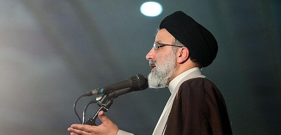 cc Meghdad Madadi, modified, https://commons.wikimedia.org/wiki/File:Ebrahim_Raisi_in_9th_Day_Rally_03.jpg